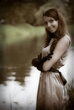 Beautiful vintage woman in summer park. Portrait of a beautiful vintage woman in summer park Royalty Free Stock Photos