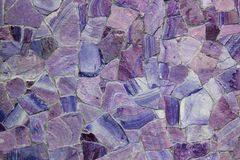 Beautiful violet colors facing stones background royalty free stock image
