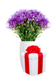 Beautiful violet flowers in vase and gift box isolated on white Stock Image