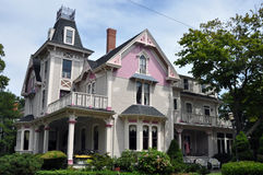 Beautiful violet and fuchsia Victorian house Royalty Free Stock Image