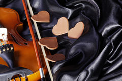 Beautiful violin on a black satin Royalty Free Stock Images