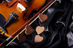 Beautiful violin on a black satin Royalty Free Stock Photography