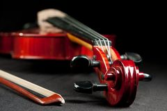 Beautiful violin and bow on dark bakground Royalty Free Stock Images