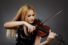 Beautiful violin player Royalty Free Stock Photography
