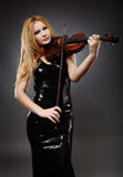 Beautiful violin player Stock Photo