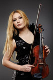 Beautiful violin player Royalty Free Stock Images