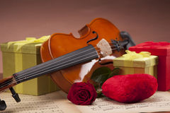 Beautiful violin and presents on notes! Stock Photo