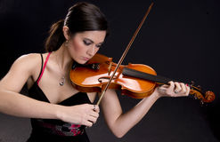 Beautiful Violinist Plays Musci on Stringed Instru Royalty Free Stock Images
