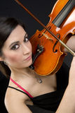 Beautiful Violinist Looks at Camera While Playing Stock Image