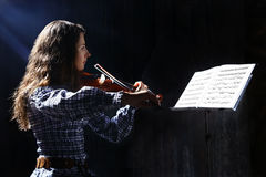 Beautiful violinist musician Stock Images