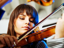Beautiful violinist playing Stock Images