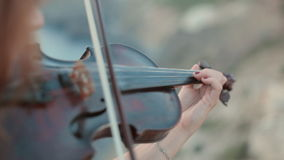 Beautiful violinist plays outdoors stock video