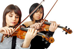 Beautiful violinists. Two beautiful violinists playing isolated on white background Royalty Free Stock Images