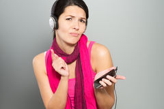 Beautiful vivacious woman listening to music Stock Images
