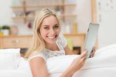 Beautiful vivacious woman with a tablet Stock Photos