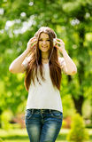 Beautiful vivacious young woman listening to music Royalty Free Stock Photo