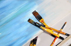 Art palette and paintbrushes Royalty Free Stock Photo