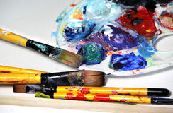 Art palette and paintbrushes Stock Photos