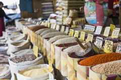 Beautiful vivid oriental market with bags full of various spices Stock Images