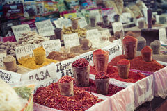 Beautiful vivid oriental market with bags full of various spices Stock Image
