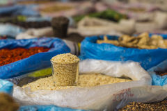 Beautiful vivid oriental market with bags full of various spices Royalty Free Stock Image
