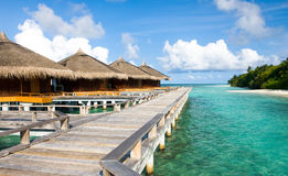 Beautiful vivid over beach with the water villas Stock Photo
