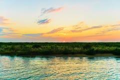 Louisiana Sunset. A beautiful vivid sunset on a Louisiana bayou royalty free stock image