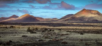 Beautiful volcanic landscape background. Mountain range with lava fields in the foreground. Lanzarote, Canary Islands royalty free stock photography