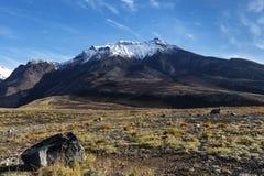 Volcanic landscape of Kamchatka on background of blue sky. Beautiful volcanic landscape of Kamchatka Region: autumn view of Kozelsky Volcano on background of Royalty Free Stock Image