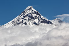 Beautiful volcanic landscape: view on volcano above clouds Royalty Free Stock Images