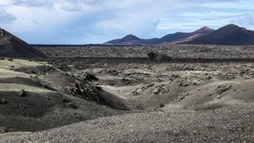 Beautiful volcanic mountain range with lava fields. In the foreground stock image