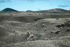 Beautiful volcanic mountain range with lava fields. In the foreground royalty free stock photos