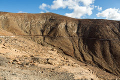 Beautiful volcanic mountains and the road on a mountain slope. Royalty Free Stock Images