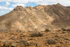 Beautiful volcanic mountains and the road on a mountain slope.  Road from la Pared to Betancuria Stock Photography