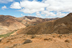 Beautiful volcanic mountains and the road on a mountain slope.  Road from la Pared to Betancuria . Fuerteventura. Stock Photography