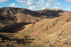 Beautiful volcanic mountains and the road on a mountain slope.  Road from la Pared to Betancuria . Fuerteventura Stock Photography