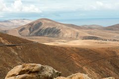 Beautiful volcanic mountains and the road on a mountain slope.  Road from la Pared to Betancuria . Fuerteventura. Canary Islands Stock Photography