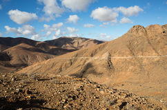 Beautiful volcanic mountains and the road on a mountain slope.  Road from la Pared to Betancuria . Fuerteventura. Canary Islands Stock Image