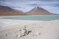 Beautiful volcano landscape with a green lagoon Stock Images