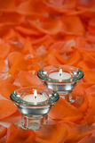 Beautiful votive candles. With rose petals around them Royalty Free Stock Images