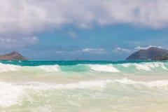 Beautiful Waimanalo beach with turquoise water and cloudy sky, Oahu coastline stock photography