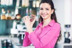 Beautiful waitress with cocktail shaker stock photo
