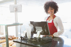 Beautiful waitress posing behind the counter Royalty Free Stock Images
