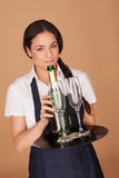 Beautiful waitress serving champagne Royalty Free Stock Photos