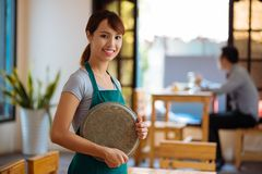 Beautiful waitress with a tray Royalty Free Stock Photo