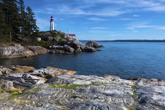 Pacific North West Vancouver Lighthouse Sky Ocean Landscape Background. A beautiful walk along Vancouver`s Lighthouse Park trail in West Vancouver BC, Canada Royalty Free Stock Photos