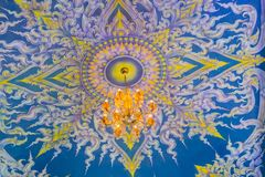 Beautiful wall and ceiling paintings in thai fine art pattern at Wat Rong Suea Ten Temple, also known as the Blue Temple, locate a stock photography