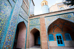 Beautiful walls with colorful tiles & minaret of Jameh mosque built 1812 Stock Image