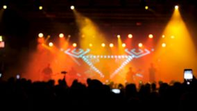 Beautiful warm lights in the background of a rock band performing on the stage stock video footage