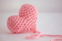 Beautiful warm pink crocheted heart - closeup Royalty Free Stock Photography